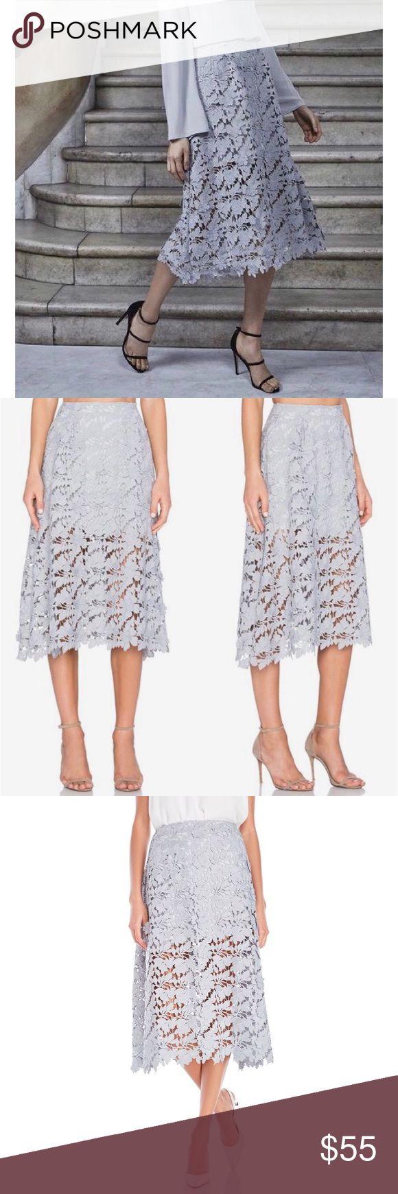 Keepsake Lace Midi Skirt Beautiful powder blue lace midi skirt. Shorter under skirt. Back exposed zipper. 100% Polyester. Worn once. KEEPSAKE the Label Skirts Midi