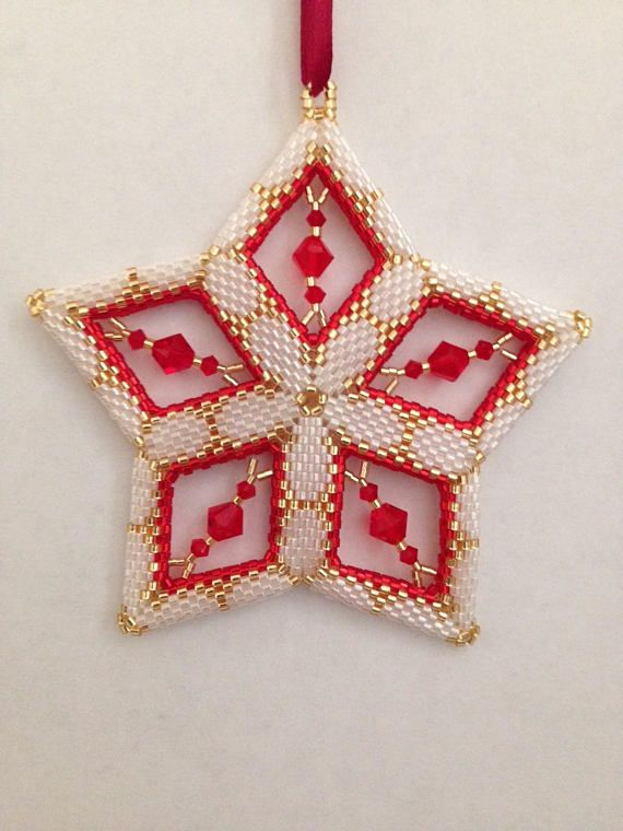 Handmade Beaded Star Ornament featuring Swarovski Crystal Bicone Beads Handmade ornament is constructed from Japanese Delica seed beads-sizes 11 and 15. Each bead is added one or two at a time using a peyote weave. This ornament features almost 2000 white and gold seed beads and 5
