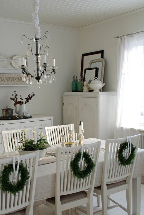Mini Christmas wreaths in an all white living room