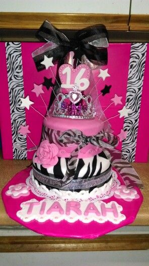 My girls 16th cake i took a chance to make... First time ever trying zebra print fondant and layered cake... Not bad for my first attempt... She loved it