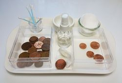 Polishing copper coins with salt and vinegar (or lemon juice)