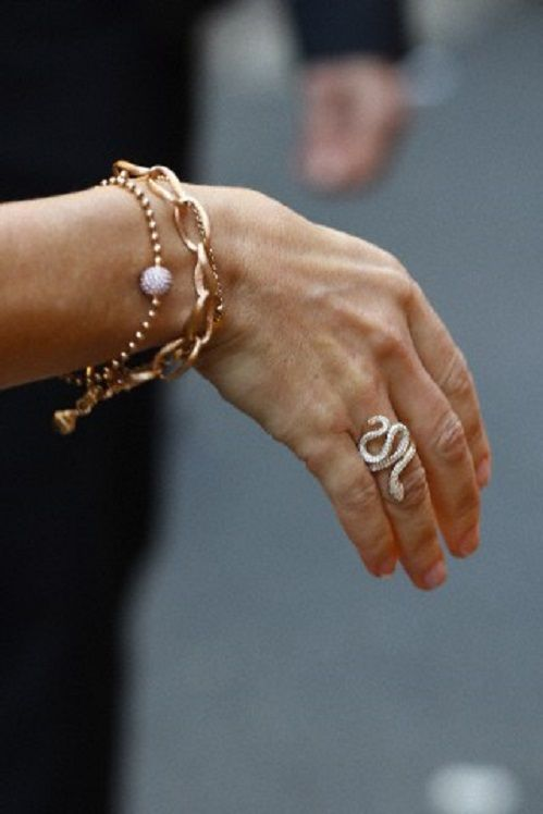 Princess Mary's jewelry details, during the Ole Lynggaard Copenhagen store opening in Sydney, NSW, Australia.  The diamond encrusted snake ring,  tired this one on too.