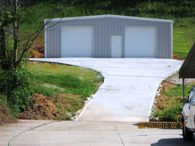 Buck Steel offers many different styles of pre engineered Metal buildings.  All of our steel structures are custom designed to fit your needs.  This metal storage garage is a 40 x 60 x 12 it has (2) 10 x 10 commercial roll up doors, (1) walk door and is l
