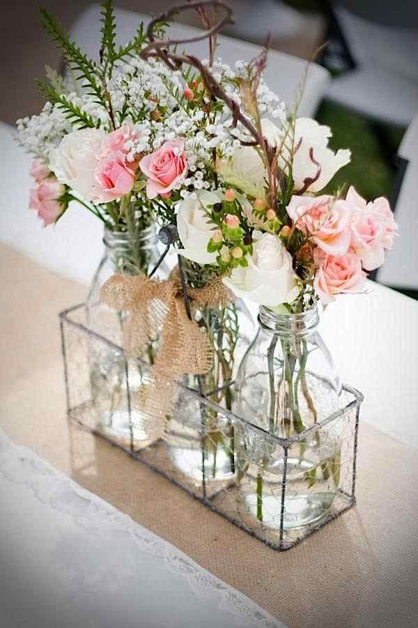 Simple florals in glass bottles for an inexpensive rustic centerpiece #centerpieceidea