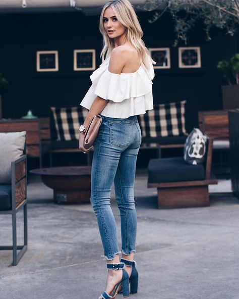 Lauren Bushnell is seen in chunky blue suede heels. She pairs these with skinny, faded denim jeans, and an off the shoulder floaty white top, the perfect street chic combo