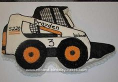 Homemade Bobcat Cake: I made this cake for my 3 yr old son. He has been wanting a bobcat cake for months. His daddy has taken him for many bobcat rides, so this was defiantly
