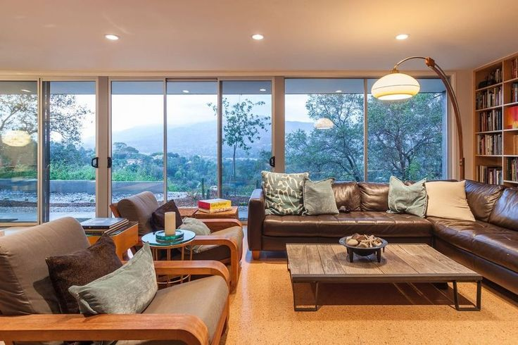 Mid-century Homes   Up in the hills of La Cañada Flintridge, this fantastic 1953 residence on its own little acre of land sits, with walls of glass on two sides of the living room area and throughout the house.  #LAhomes #midcenturyhomes #homesinlosangeles