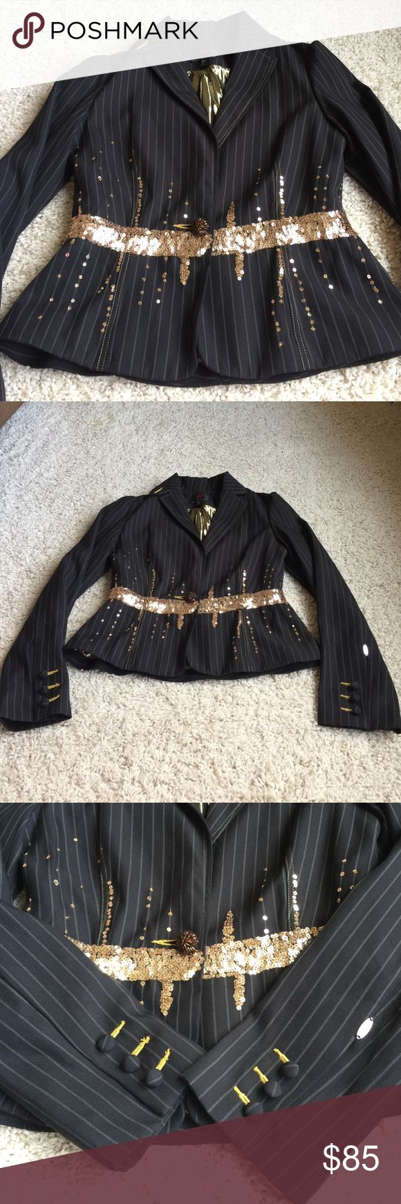 Gold sequin jacket This beautiful black and white pinstripe jacket with gold sequin detail on the front of the jacket, around the waist of the jacket and the back of the jacket is beautiful. There is a gold beaded button to close the front of the jacket. The inside is gold and red and black stripes. The brand is True Meaning and it is a women's size 6. This is perfect for the holidays! True Meaning Jackets & Coats