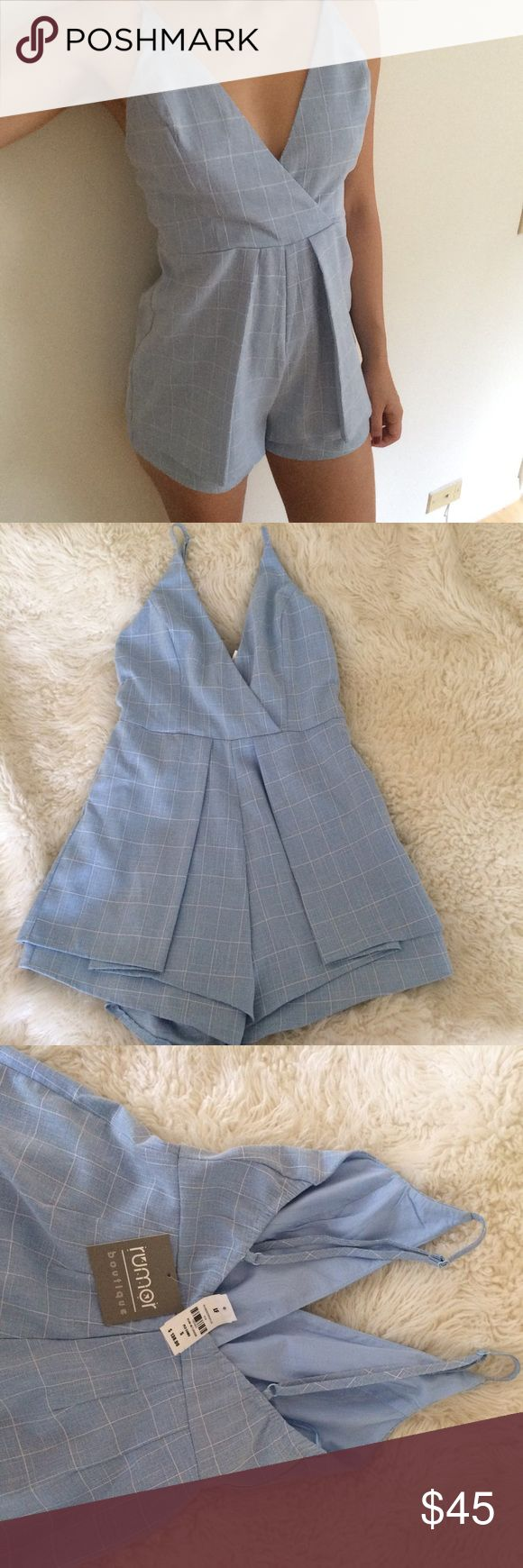 Blue and white striped pleated nautical romper Brand-new never worn with tags still attached. Features pleaded short and adjustable straps, with back zipper. Bought from LF store LF Pants Jumpsuits & Rompers