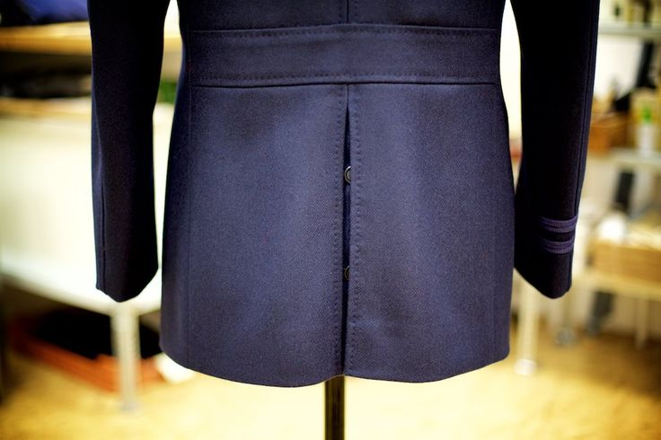 The back of our Naval Pea Coat features a buttoned double-vent below the belt.