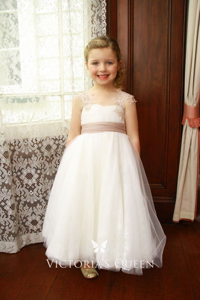 217857b7c Floor length flower girl dress for less created in delicate ivory tulle  fabric. Lace cap sleeves. Soft circular skirt comes into A-line silhouette.