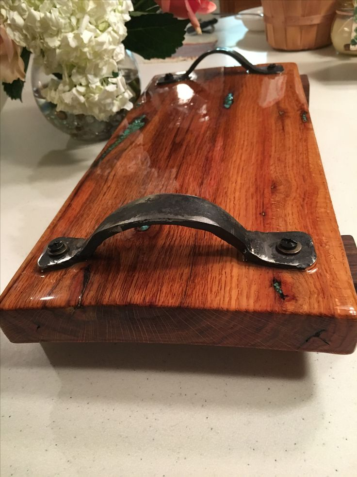 Handles were forged from a metal working class given by our local college to match a rustic serving platter/ cutting board