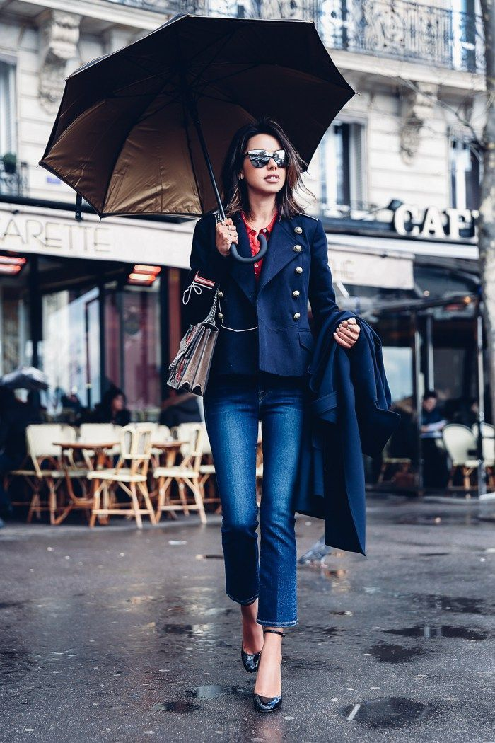 Fitted navy blue blazer with gold buttons, ankle jeans