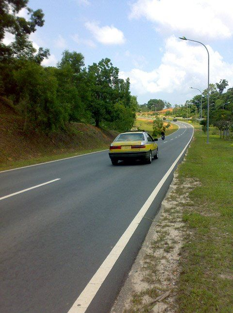 Yellow taxi at main road #Batam