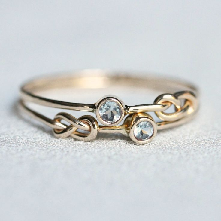 Choose Two Stones - SOLID 14k White or Yellow Gold - Tiny Birthstone Stacking Rings - Infinity Knots and Stones of Your Choice - Delicate by MARYJOHN on Etsy https://www.etsy.com/listing/208416105/choose-two-stones-solid-14k-white-or