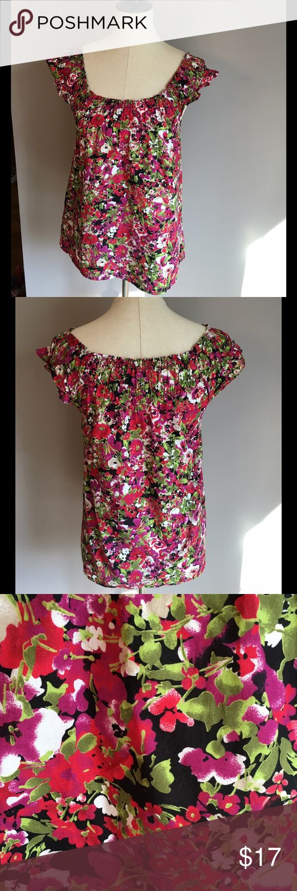 ❤️❤️Flirty floral top by LOFT❤️❤️ LOFT scoop neck floral blouse in gorgeous shades of red, black, green, purple, and white. Size medium petite. Short sleeves. Elastic at the neckline of top adds a very flattering look! LOFT Tops Blouses