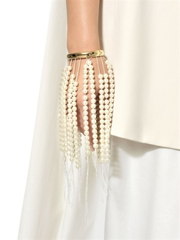 """Frm bd: Pearls Pearls Pearls """"Unusual and not for the office, certainly. The attraction for me is the tactile sensation of the beads as they swing past the flesh when you move!"""""""