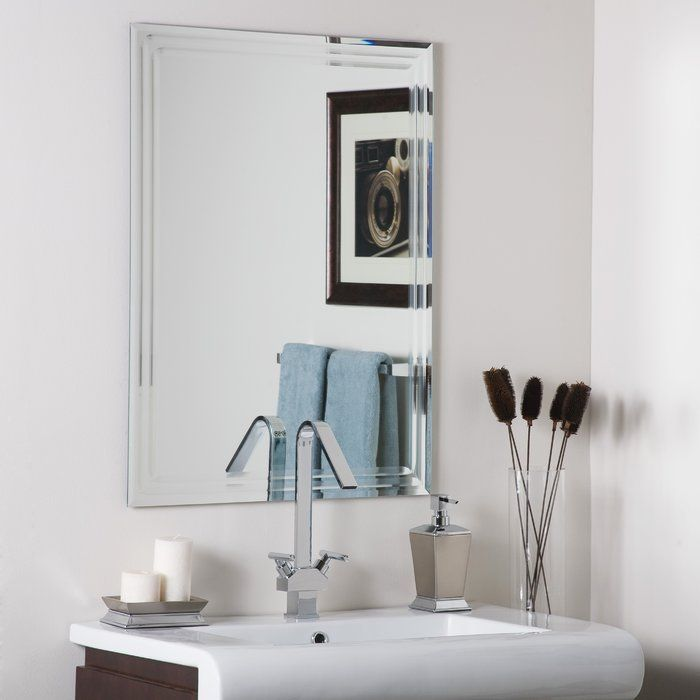 """The Brayden Studio Frameless Tri Bevel Wall Mirror is of a simple design with clean straight lines and no embellishments to speak of. This modern frameless mirror complements any decor, whether traditional or modern. It adds a sparkle to your living space, thus making it warm and enjoyable. The Brayden Studio Frameless Tri Bevel Wall Mirror is made of glass that is a sturdy (0.19"""") thick and protectively contained in a metal construction. With a durable silver backing of double coats…"""