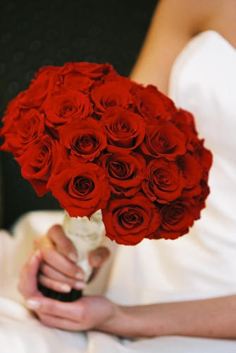 Classic red rose bouquet.  Flowers by @petalsedgedc.