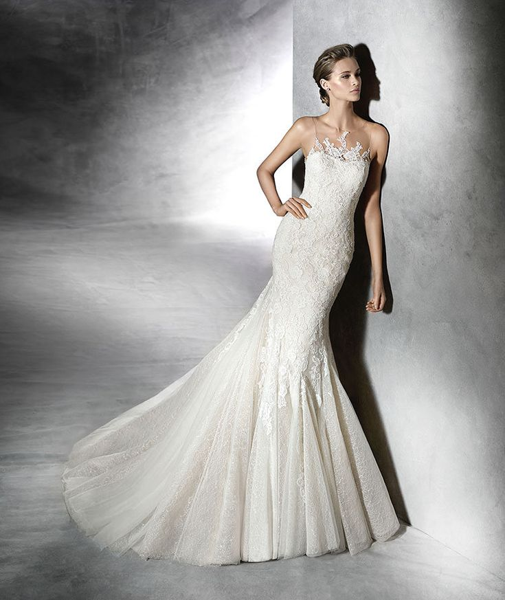 The New Design Wedding dress, beige tulle, flared with lace and thread embroidery appliqus. Bodice with sheer underbodice at the front and back decorated with lace appliqus in the center. Free Measurement
