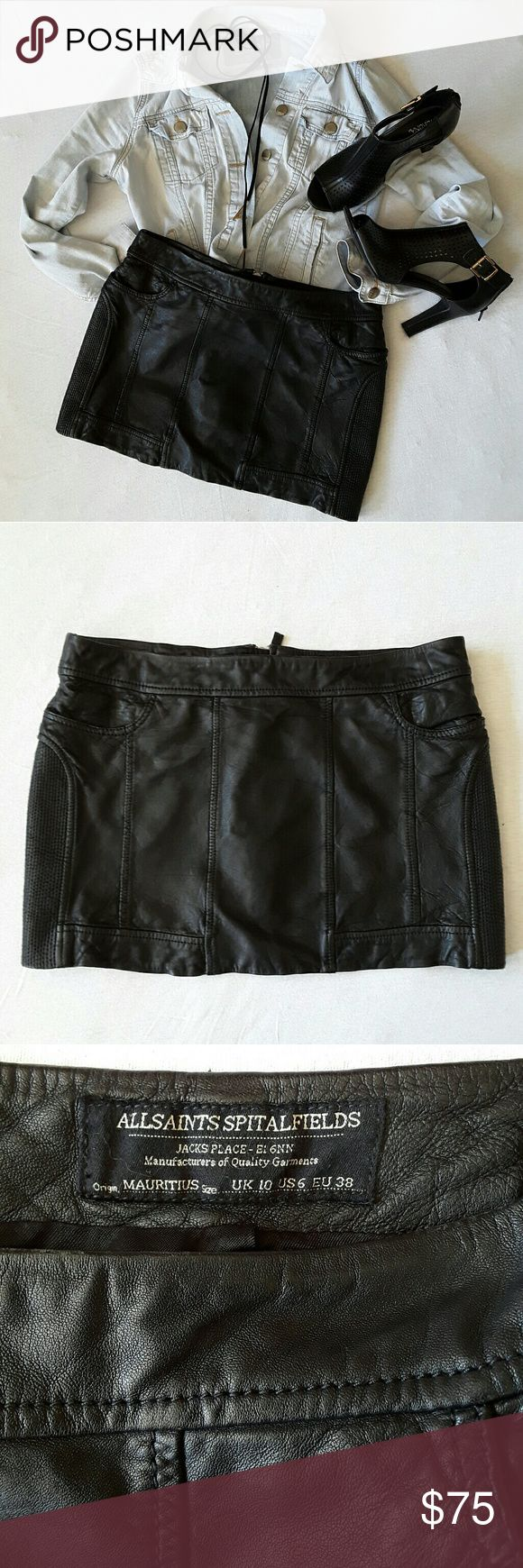 All Saints Biker Leather Minister Skirt size 6 Euc, no flaws, just signs of gentle wear. The skirt has two front pockets and slightly elastic panels on each side. There is a zipper in the back that fully opens (see picture). Two faux back pockets,  meaning it only looks like there are pockets in the back. Shell 100%leather,  lining 100% viscose. Length (including 1.5 inches waistband) ca. 12.25 inches, waist ca. 33 inches. All Saints Skirts Mini