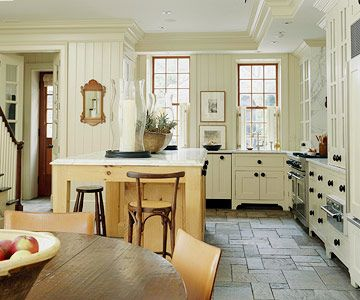 """I love the look of furniture in the kitchen. And I'd imagine this is what I could do if I removed the drop ceiling in my kitchen, but left some """"around the edges"""" for effect. With the crown moulding, of course."""