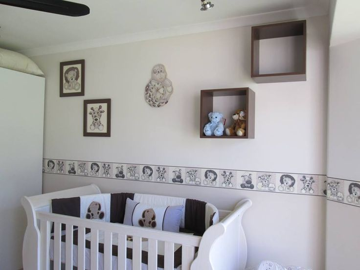 Jungle animals nursery in blue and stone, wall painted in cream and stone, divided by a gorgeous wallpaper border. Cot linen to co-ordinate the borders and nursery decor.  Contact Tiny Interiors for more information or Border Boutique (Facebook).