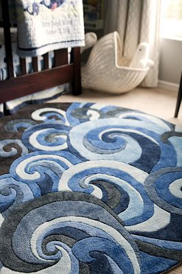 Great wave rug by Momeni, Lil Mo Hipster LMT-1 Surf, in an adorable whale-themed nursery by Amusemintz