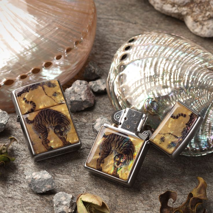 http://www.antiquealive.com/store/detail.asp?idx=5167&CateNum=167&pname=Zippo-Mother-of-Pearl-Cigarette-Lighter-with-Tiger-under-Pine-Tree-Painting Zippo Mother of Pearl Cigarette Lighter with Tiger under Pine Tree Painting