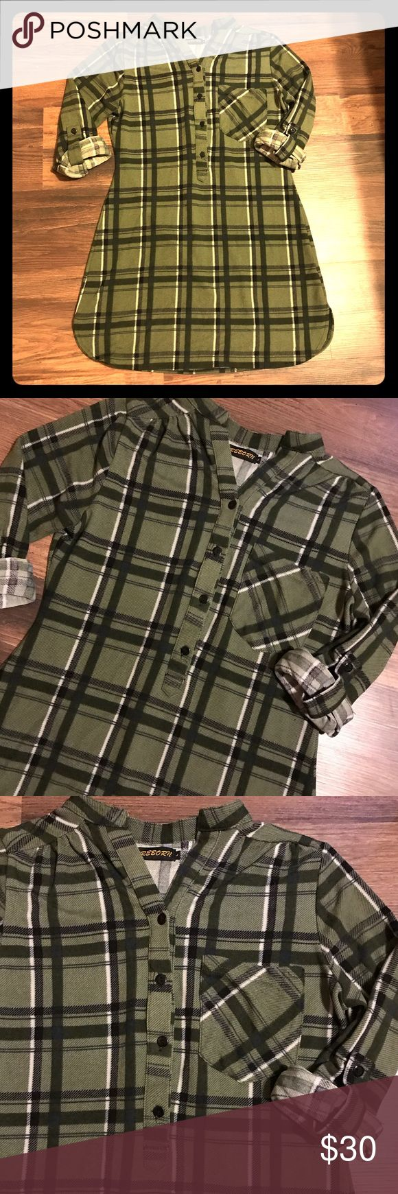 Reborn. Green Flannel Tunic/Dress size Large. Super cute green plaid flannel Dress Tunic made by Reborn. Size Large. Runs like a medium. New never been worn. Reborn Dresses