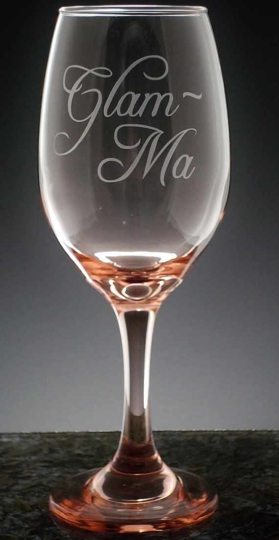 The price is for one wine glass.  Our Glam Ma wine glass is a fabulous way to reveal someone special is going to be a Grandma! The wine glass holds 13 oz. and stands about 8 inches tall. Available in four great colors: Clear, Blue, Peach or Green.  We can add a first name on the back for an additional charge.  Our personalized items are hand crafted by using a vinyl mask and then sand blasted for a permanent and elegant look. Please convo me with the last name and be sure to double check the…