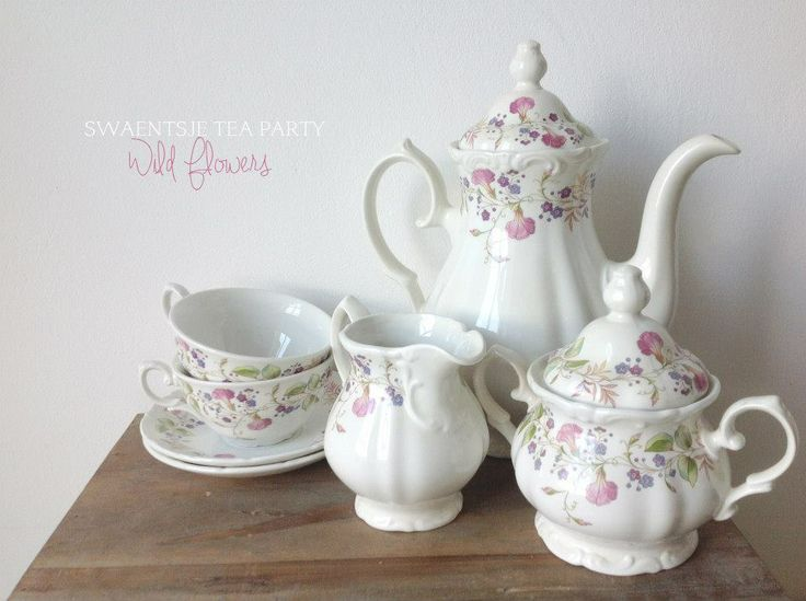The following item on display features a 7 piece antique tea set (marked 'Pontesa Royal China'), decorated with very delicate pink and purple wild flowers. This tea set goes especially well with our handmade cake stand 'Turtle Doves' (sold separately) as pictured in the last photo. Decorate your tea party, wedding or bridal party with this cute set.