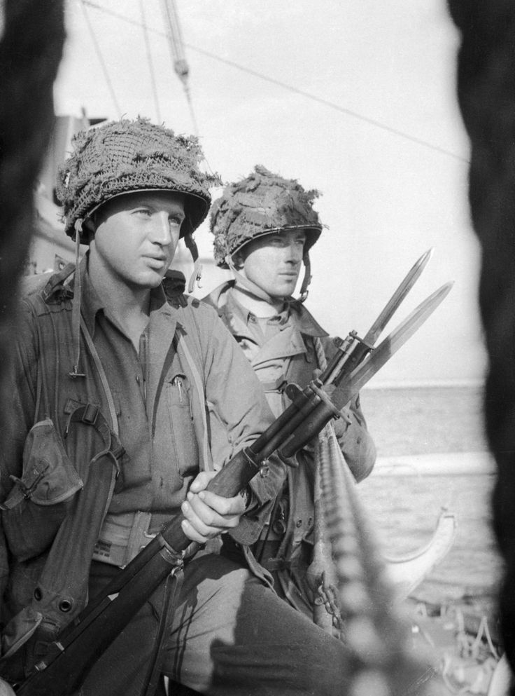 "Bayonets at the ready as the U.S. troops prepare to take their designated strips of the Normandy beach, codenamed ""Omaha"" and ""Utah."" 