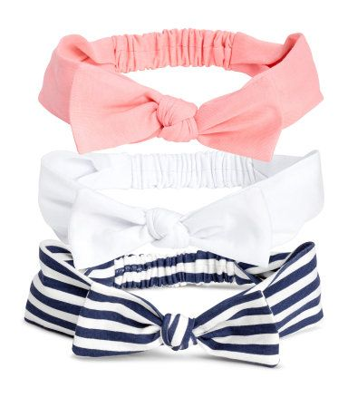 Dark blue/white striped. Jersey headbands with an attached bow at front and elastication at back.
