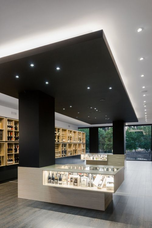 """Bottles' Congress is a minimalist interior located in Braga, Portugal, designed by Tiago do Vale Arquitectos. The """"Bottles' Congress"""" project came as an answer to very particular challenges presented by a wine and spirits store in unique circumstances. (6)"""