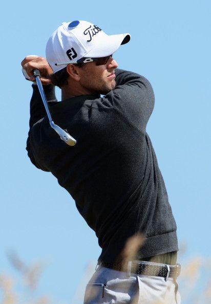 Adam Scott (golfer) Adam Scott of Australia hits a shot ahead of the 142nd Open Championship at Muirfield on July 15, 2013 in Gullane, Scotland.