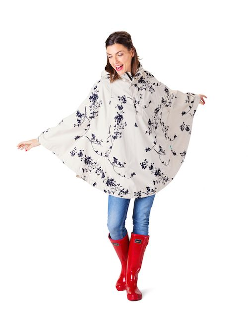 Festival rain cape. Dance in the rain with this waterproof festival poncho. Shop it online: http://happyrainydays.com/eu/shop/raincapes-raintrousers/rain-poncho-beau/