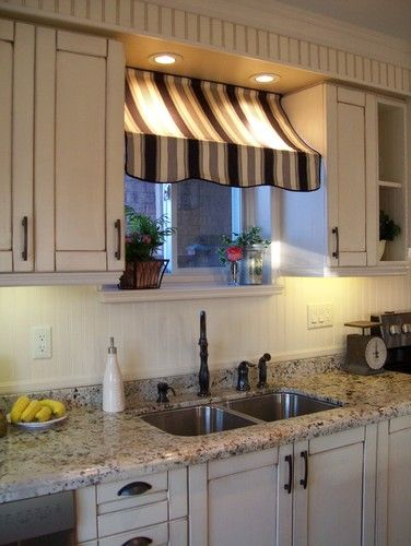 DIY awning? Looks like you could use two tension rods to get this look between cabinets.