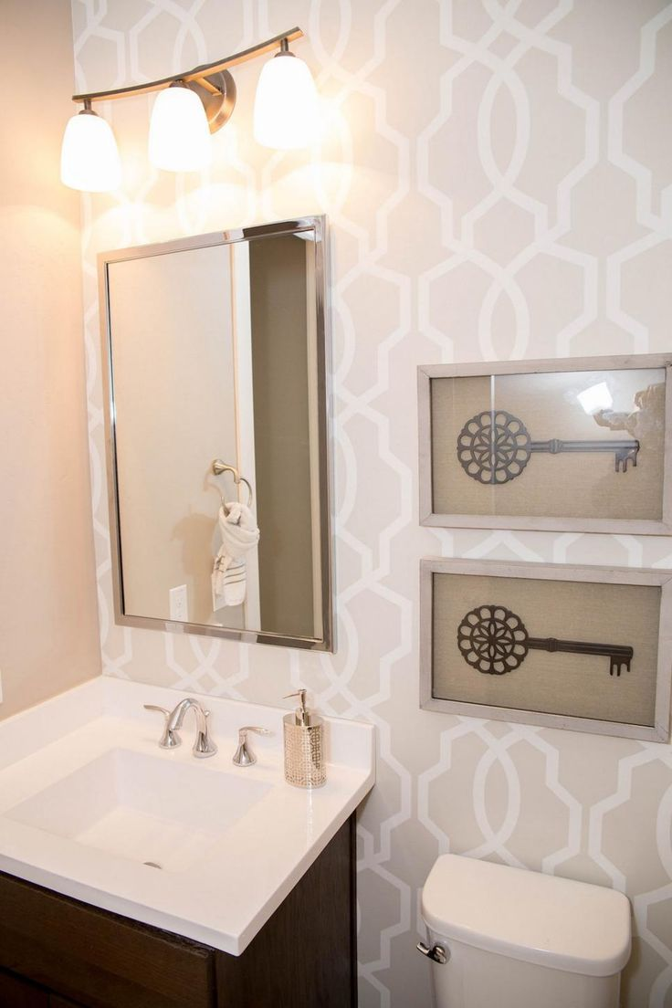 Neutral, graphic wallpaper takes this small bathroom from basic to chic.