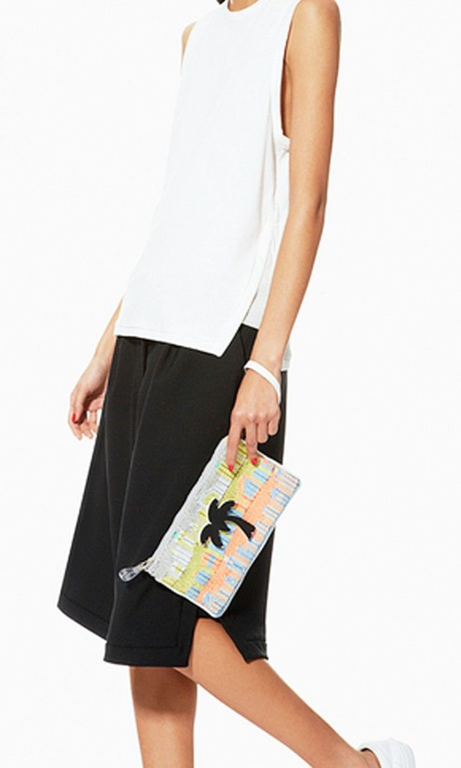 Give your look a hint of art deco-cool with this textured neon pouch.
