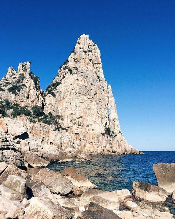 """by http://ift.tt/1OJSkeg - Sardegna turismo by italylandscape.com #traveloffers #holiday   Where the mountain meets the sea { #Ogliastra } Pedra Longa é un monumento naturale che segna l'inizio della spettacolare costa di #Baunei. Il suo nome significa """"pietra alta"""" e al suo cospetto si capisce il perché: 128 metri di roccia calcarea a picco su un mare blu profondo  #pedralonga #sardiniaexperience Foto presente anche su http://ift.tt/1tOf9XD   February 23 2016 at 02:00PM (ph rena.ra )…"""