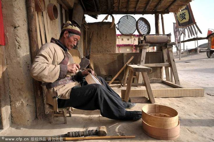 craftsman makes a flour sifter  in China