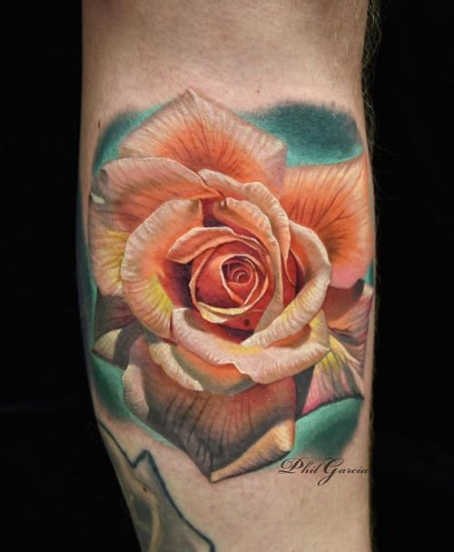 Realistic rose tattoo by Phil Garcia