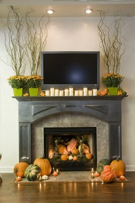 Love those pumpkins in the fireplace!