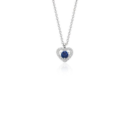Delicate in design, this pendant features a beautiful sapphire gemstone surrounded by sparkling micropavé diamonds framed in 14k white gold.