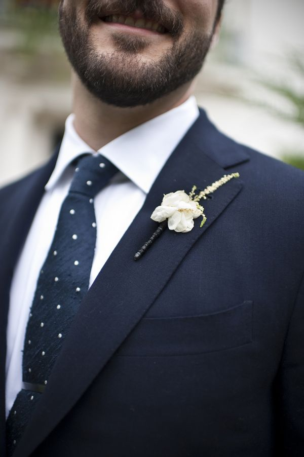 Crisp Navy Grooms Suit with a Polka Dot Tie | BRC Photography | See More! http://heyweddinglady.com/impossibly-chic-modern-art-inspired-wedding/