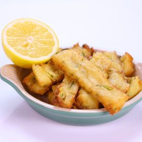 Chickpea Zucchini Fries | Mario Batali 4 cups water3 cups Chickpea Flour4 cups Zucchini (grated; or 2 large Zucchini)Olive Oil for deep frying1 Lemon (cut into wedges)Salt to taste