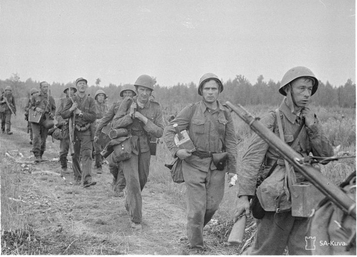 Tired Finnish soldiers on the march, August 1941.