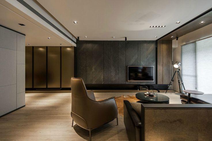Stone And Wood Make A Dark Masculine Interior Interior