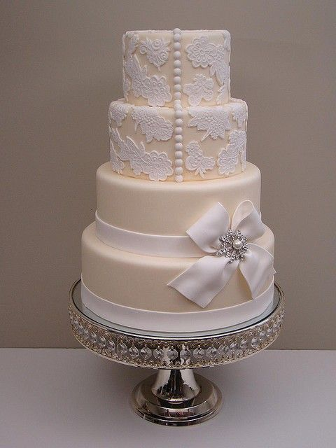 a classical elegant wedding cake . a tiny bit plain but nice if you like this sort of thing